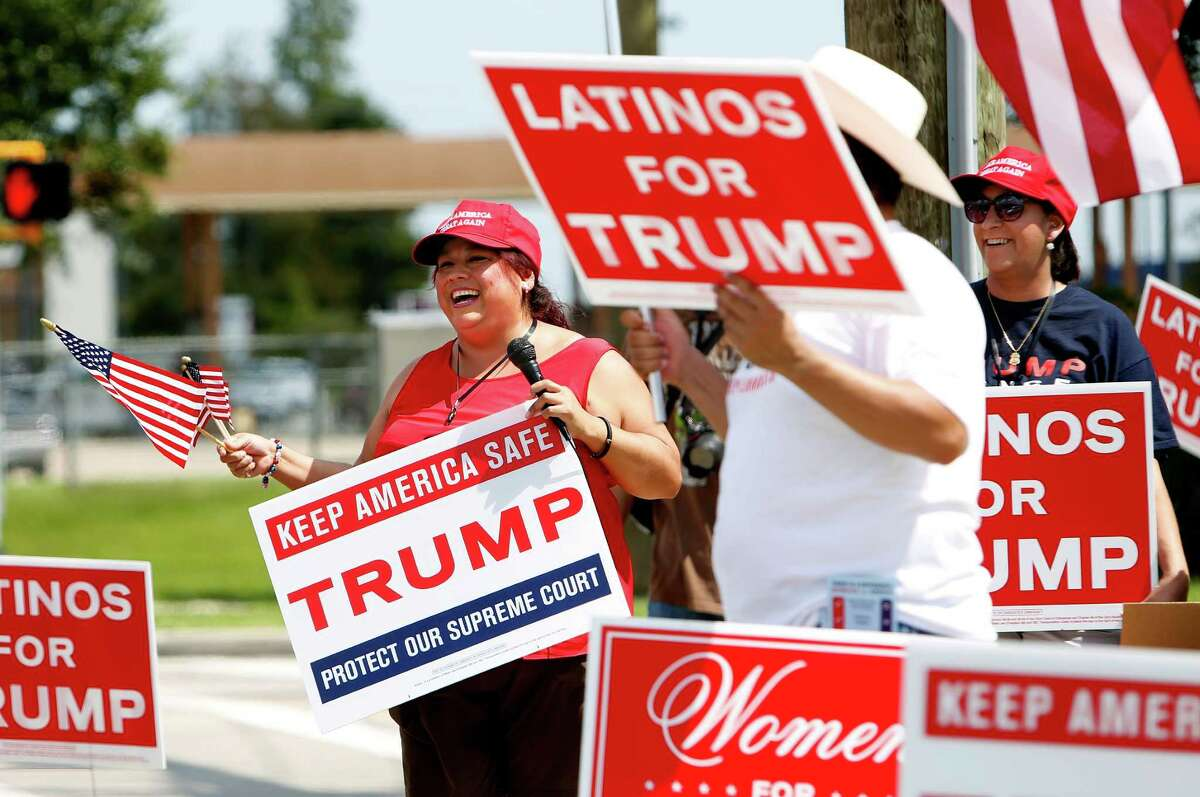 Sylvia Castillo joins other Trump supporters at the intersection of Pansy Street and Fairmont Parkway in support on Sunday, Sept. 18, 2016, in Pasadena.