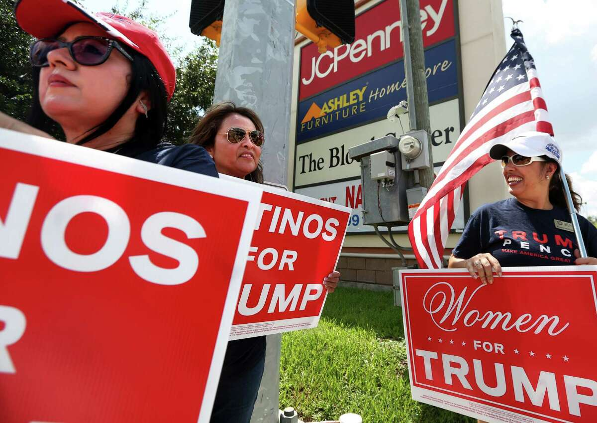 Team Trump members Hope Cruz, Marri Velasquez and Emely McHattie show support for Donald Trump in Pasadena on Sunday, Sept. 18, 2016. Although Latinos for Trump is a fairly new organization, the women have been waving signs, working phone banks and hosting watch parties for Trump for over a year.