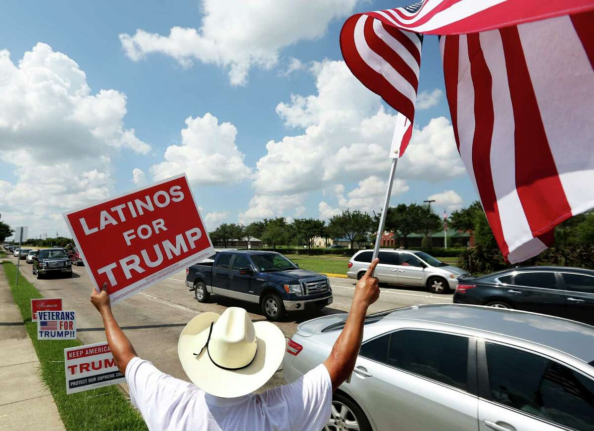 John Coronado rallies Trump supporters at the intersection of Pansy Street and Fairmont Parkway on Sunday, Sept. 18, 2016, in Pasadena.