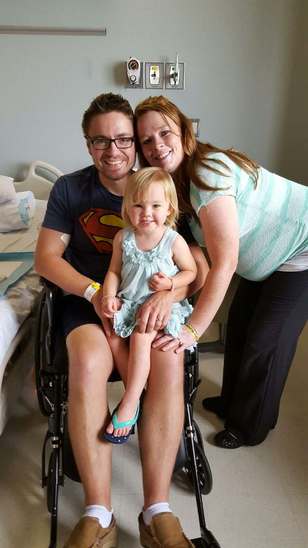 Pasadena Police Lt. Thomas Warnke with his wife, Keleigh, and daughter, Scarlett, on Easter Sunday at The Institute for Rehabilitation and Research at Memorial Hermann in the Texas Medical Center. Warnke was undergoing rehabilitation treatment for transverse myelitis, a neurological disorder that had suddenly paralyzed him from the waist down.