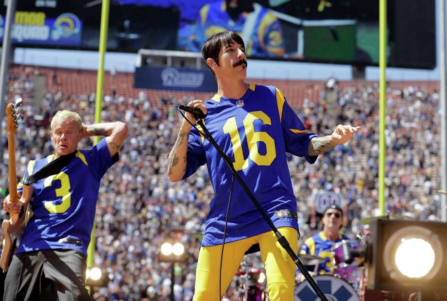The Red Hot Chili Peppers perform prior to an NFL football game between the Los Angeles Rams and the Seattle Seahawks at Los Angeles Memorial Coliseum, Sunday, Sept. 18, 2016, in Los Angeles. (AP Photo/Jae Hong) Photo: Jae Hong, Associated Press / Copyright 2016 The Associated Press. All rights reserved.