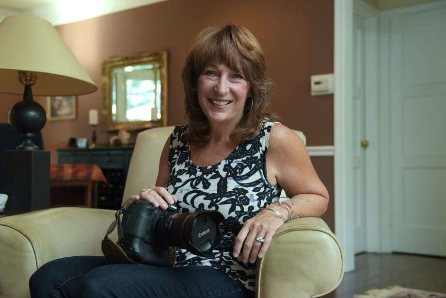 Trish Hennessy poses with her camera at her home on Wednesday, Sept. 7, 2016, in Albany, N.Y.    (Paul Buckowski / Times Union) Photo: PAUL BUCKOWSKI / 20037914A