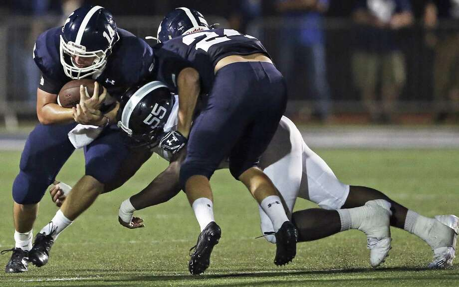 Steele defensive end Henry Willoughby is sandwiched between Smithson Valley running back Kaleb Rood (24) and quarterback Josh Adkins during a non-district game on Sept. 16, 2016. Photo: Tom Reel /San Antonio Express-News / 2016 SAN ANTONIO EXPRESS-NEWS