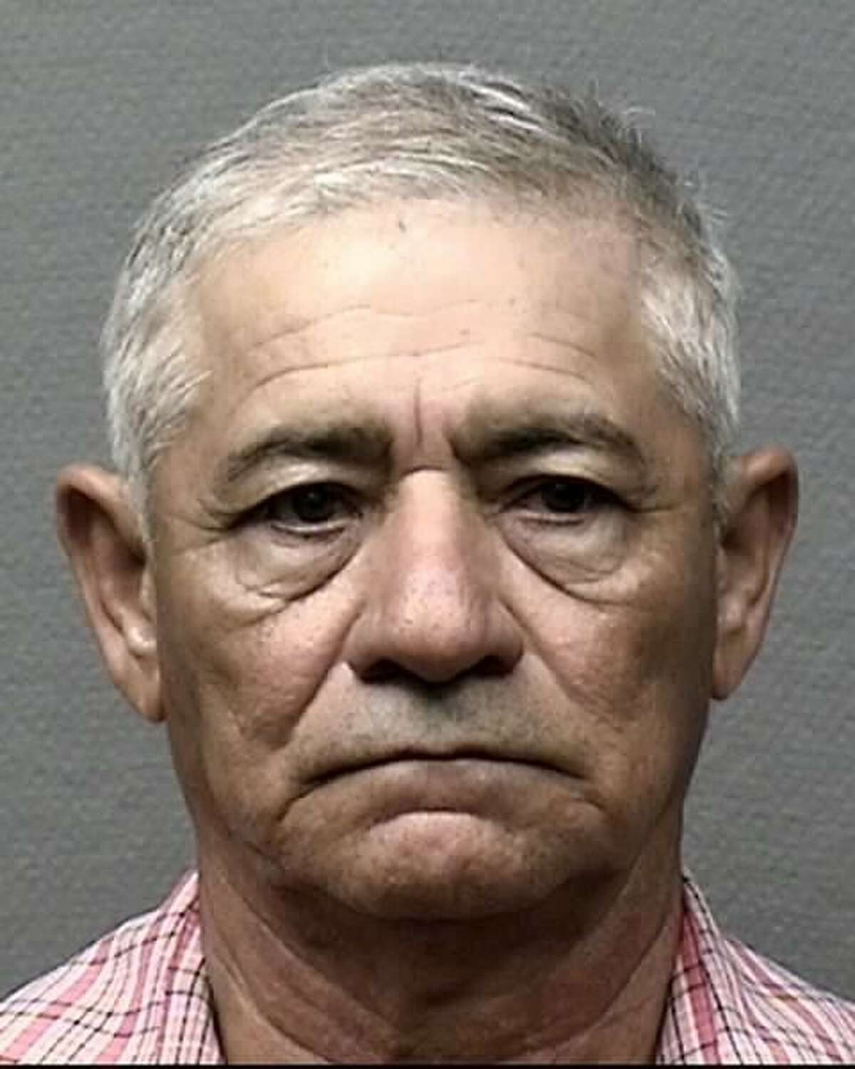 Rogelio Alberto Guardado, 69, has been charged with aggravated assault with a deadly weapon after a woman was critically injured when she was run over with a pickup about 11 p.m. Sept. 11, 2016, at 6767 Long Drive in southeast Houston. (Houston Police Department)