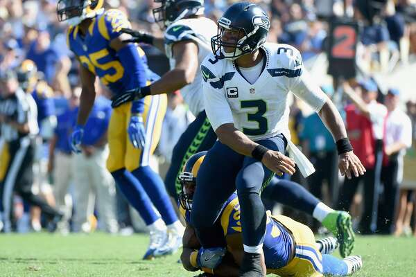 LOS ANGELES, CA - SEPTEMBER 18:  Quarterback Russell Wilson #3 of the Seattle Seahawks reacts to his pass during the fourth quarter of the home opening NFL game against the Los Angeles Rams at Los Angeles Coliseum on September 18, 2016 in Los Angeles, California.  (Photo by Harry How/Getty Images)