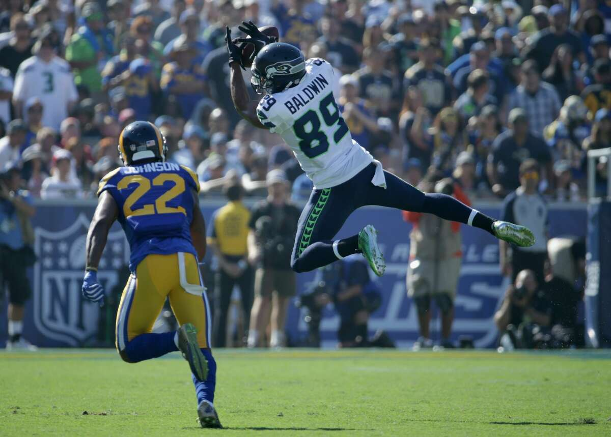 Wide receiver: B+ Doug Baldwin's play through the first three weeks (20 receptions for 276 yards and two touchdowns) should have embarrassed anyone who questioned his bona fides as a No. 1 receiver. Though he slowed down a little last week after suffering a knee injury versus San Francisco, he was good for a couple of spectacular plays against the Jets, including a tough catch on Seattle's first touchdown drive. Jermaine Kearse has been largely invisible, while Tyler Lockett has been slowed by his own knee injury. Paul Richardson and Tanner McEvoy have each made plays in limited action.