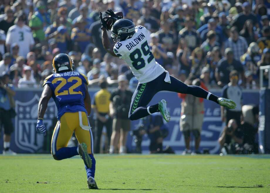Doug Baldwin #89 of the Seattle Seahawks does not complete the pass against Trumaine Johnson #22 of the Los Angeles Rams during the fourth quarter of the home opening NFL game at Los Angeles Coliseum on September 18, 2016 in Los Angeles.  (Photo by Jeff Gross/Getty Images) Photo: Jeff Gross/Getty Images