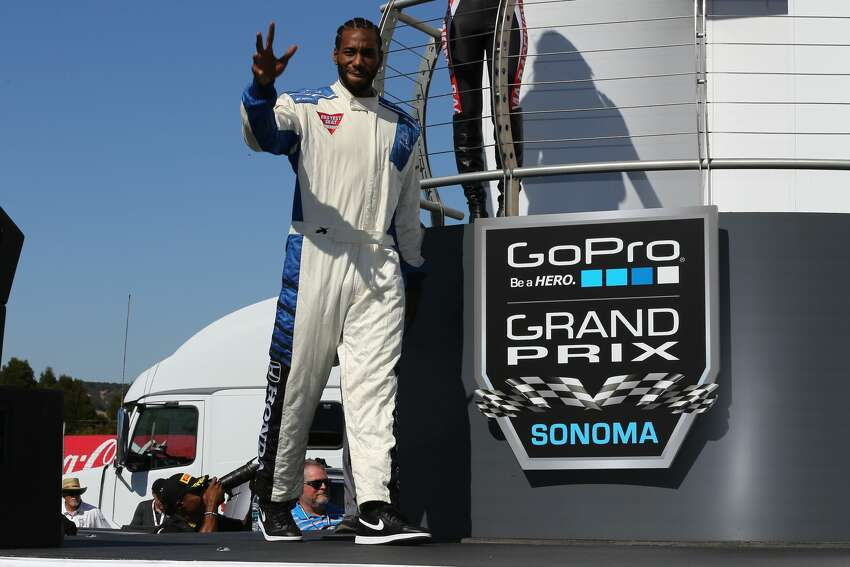 San Antonio Spur Kawhi Leonard hopped into a tandem two-seat race car with legendary driver, Mario Andretti, at the IndyCar GoPro Grand Prix of Sonoma on Sunday, Sept. 18, 2016.
