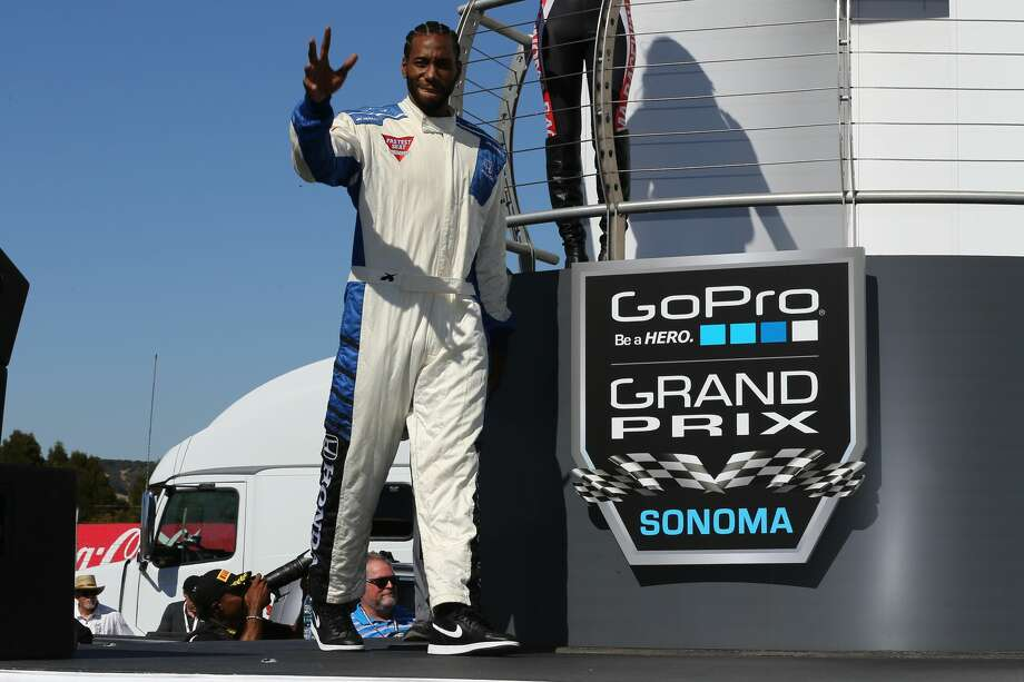 San Antonio Spur Kawhi Leonard hopped into a tandem two-seat race car with legendary driver, Mario Andretti, at the IndyCar GoPro Grand Prix of Sonoma on Sunday, Sept. 18, 2016. Photo: Courtesy, IndyCar