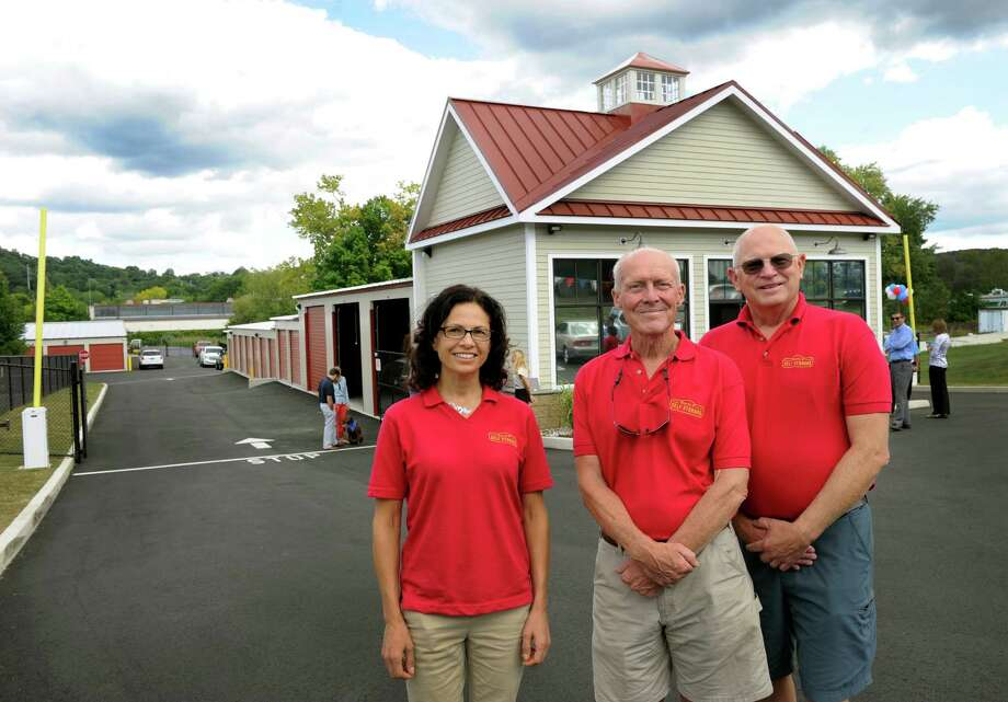 South Street Self Storage in Danbury hold an official ribbon-cutting Friday, Sept. 16, 2016. From left are Monica Roberto, manager, owners Jay Moody and brother-in-law, Kenneth Fantel. Photo: Carol Kaliff / Hearst Connecticut Media / The News-Times