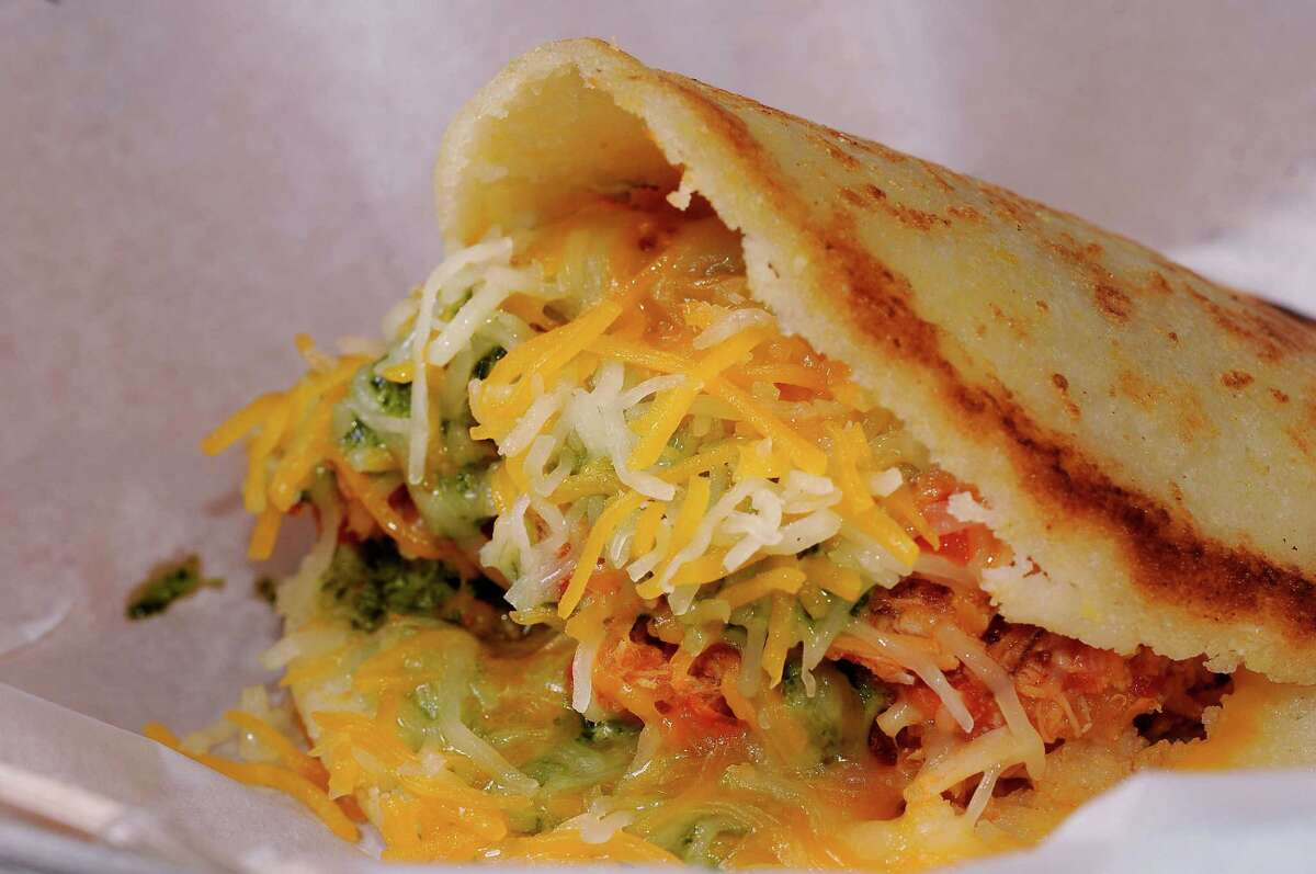 The La Catira arepas at Gusto Gourmet is made with shredded chicken, shredded cheese and homemade sauce.
