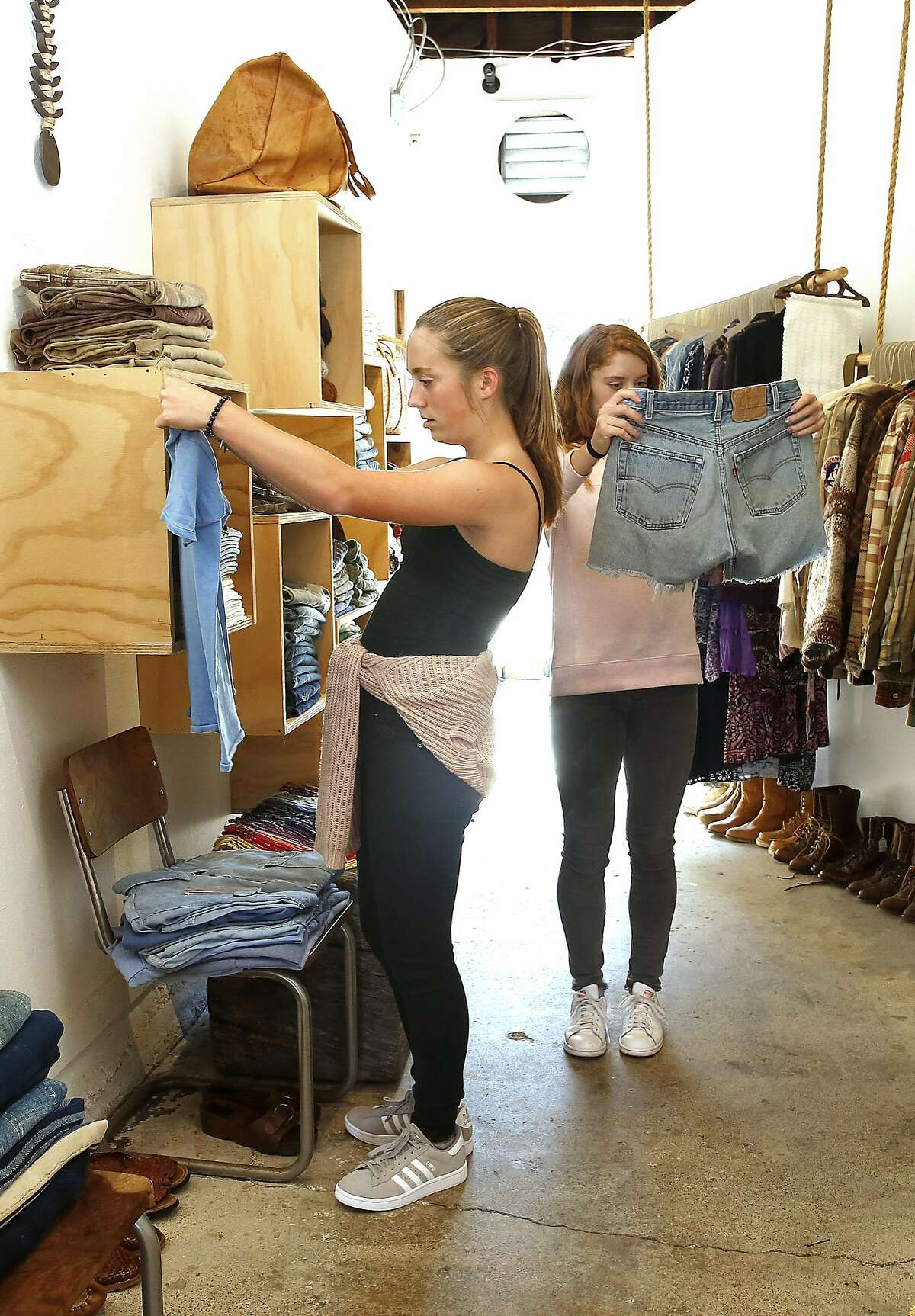 Claire Crowley (left), 14 years old, and her twin sister Madeline Crowley (middle right) shop at General Store on Wednesday, September 14, 2016, in San Francisco, Calif.