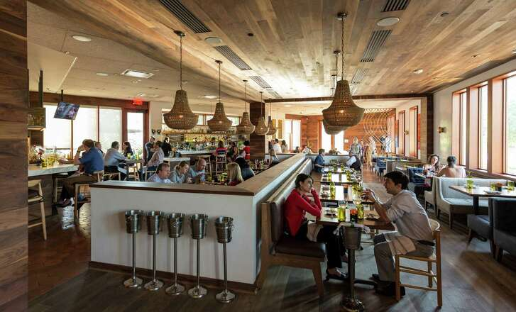 Oporto Fooding House, 125 West Gray, serves food influenced by Portugal and India. ID: interior shots showing angular counters and dining room designed by noted Austin designer Michael Hsu. Thursday   April 30, 2015