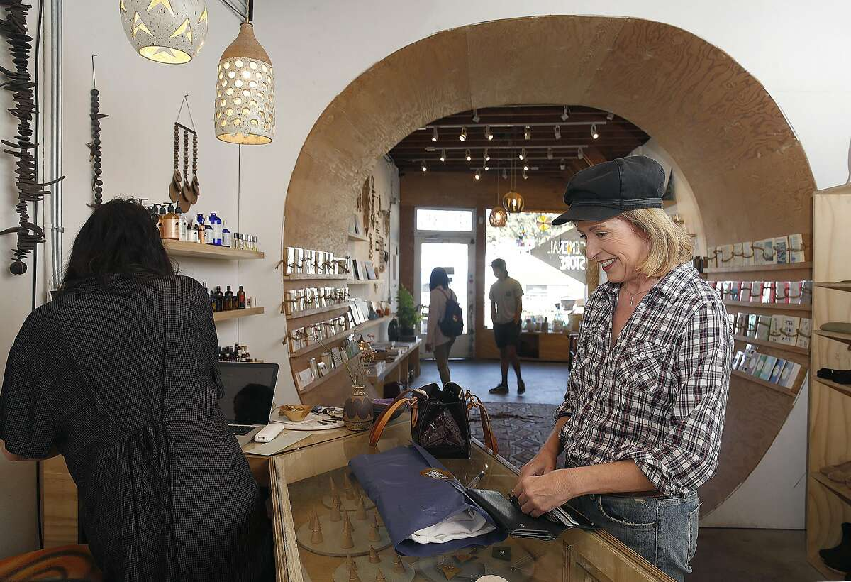 Cathy Viehweg (right) buys a Jesse Kamm jumpunit at the General Store on Wednesday, September 14, 2016, in San Francisco, Calif.