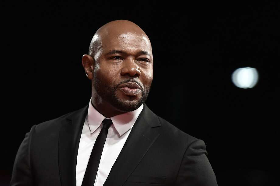 """CORRECTION - Director and executive producer Antoine Fuqua attends the Premiere of the movie """"The Magnificent Seven"""" following the ceremony awards at the 73rd Venice Film Festival on September 10, 2016 at Venice Lido.  / AFP PHOTO / TIZIANA FABI / The erroneous mention[s] appearing in the metadata of this photo by TIZIANA FABI has been modified in AFP systems in the following manner: [director Antoine Fuqua] instead of [actor Denzel Washington]. Please immediately remove the erroneous mention[s] from all your online services and delete it (them) from your servers. If you have been authorized by AFP to distribute it (them) to third parties, please ensure that the same actions are carried out by them. Failure to promptly comply with these instructions will entail liability on your part for any continued or post notification usage. Therefore we thank you very much for all your attention and prompt action. We are sorry for the inconvenience this notification may cause and remain at your disposal for any further information you may require.TIZIANA FABI/AFP/Getty Images Photo: TIZIANA FABI, AFP/Getty Images"""