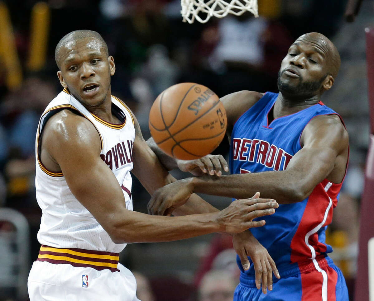 Cleveland Cavaliers' James Jones (1) and Detroit Pistons' Joel Anthony (50) vie for a rebound during the first half of an NBA basketball game Wednesday, April 13, 2016, in Cleveland.