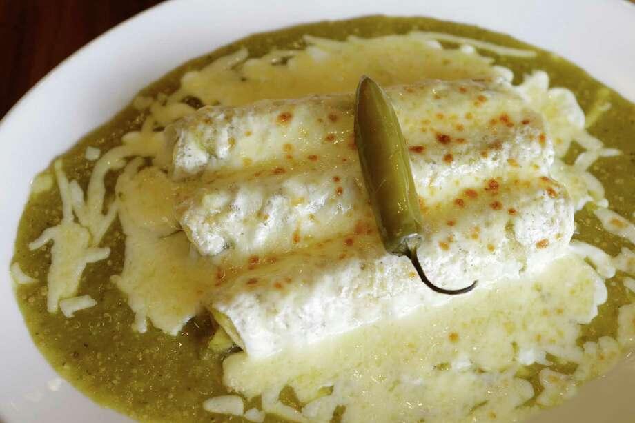 Green enchiladas at Saltillo Mexican Kitchen Photo: Melissa Phillip, Houston Chronicle / © 2015 Houston Chronicle