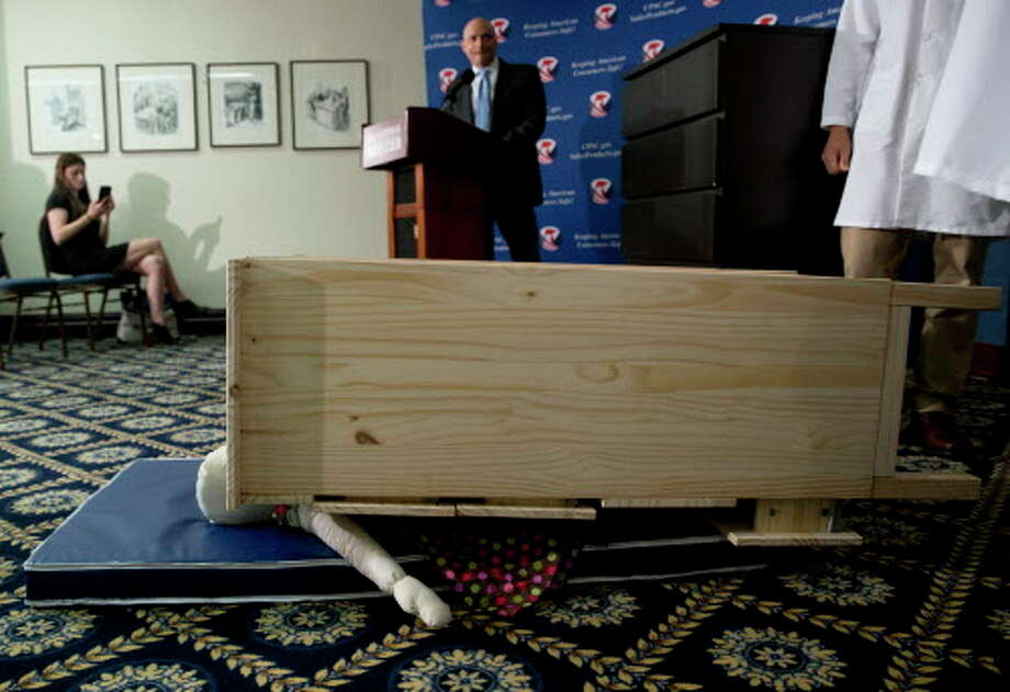 Consumer Product Safety Commission (CPSC) Chairman Elliot Kaye watches during a demonstration of how an Ikea dresser can tip and fall on a child during a news conference at the National Press Club in Washington, Tuesday, June 28, 2016. Ikea is recalling 29 million chests and dressers after six children were killed when the furniture toppled over and fell on them. (AP Photo/Carolyn Kaster) Photo: Carolyn Kaster / Associated Press / Copyright 2016 The Associated Press. All rights reserved. This material may not be published, broadcast, rewritten or redistribu