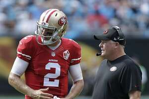 San Francisco 49ers head coach Chip Kelly, right, talks with Blaine Gabbert, left, in the second half of an NFL football game against the Carolina Panthers in Charlotte, N.C., Sunday, Sept. 18, 2016. (AP Photo/Bob Leverone)