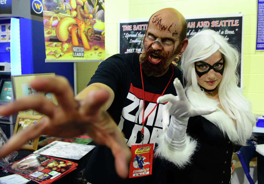 Hartford ComiCONN takes place at the XL Center Saturday and Sunday, Sept. 24 and 25. Two fans are seen here dressed in costume at the 2014 convention at Webster Bank Arena in Bridgeport. Photo: File Photo / Christian Abraham / Connecticut Post