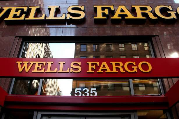 FILE - In this May 6, 2012, file photo, a Wells Fargo sign is displayed at a branch in New York. Wells Fargo is in the spotlight after its employees allegedly created up to 2 million bank and credit card accounts, transferred customers' money without telling them and even created fake email addresses to sign people up for online banking in an effort to meet lofty sales goals. When Wells Fargo CEO John Stumpf testifies before a Senate committee hearing Tuesday, Sept. 20, 2016, it won't be just his bank under fire for turning friendly branches into high-pressure sales centers. It'll be the entire industry. (AP Photo/CX Matiash, File)