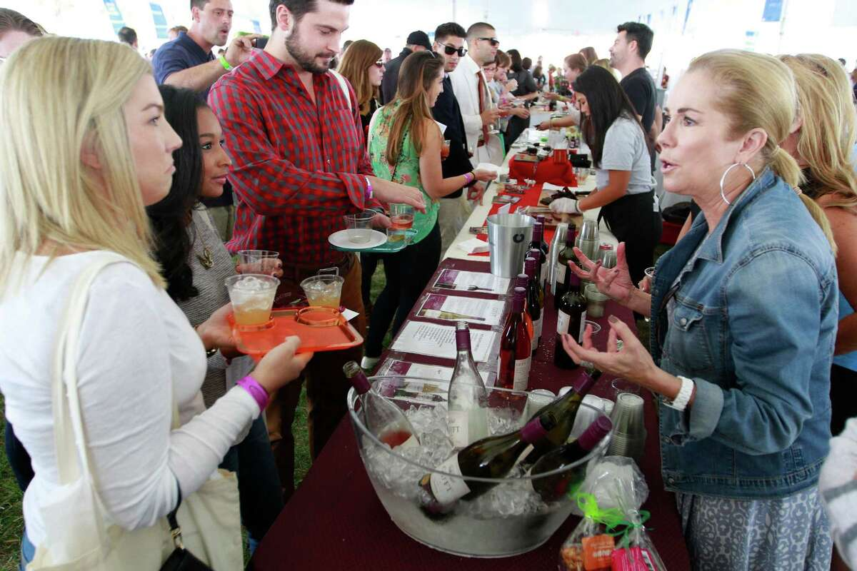 Kathie Lee Gifford, right, promotes her wine Gifft during the Greenwich 2015 Wine + Food Festival.