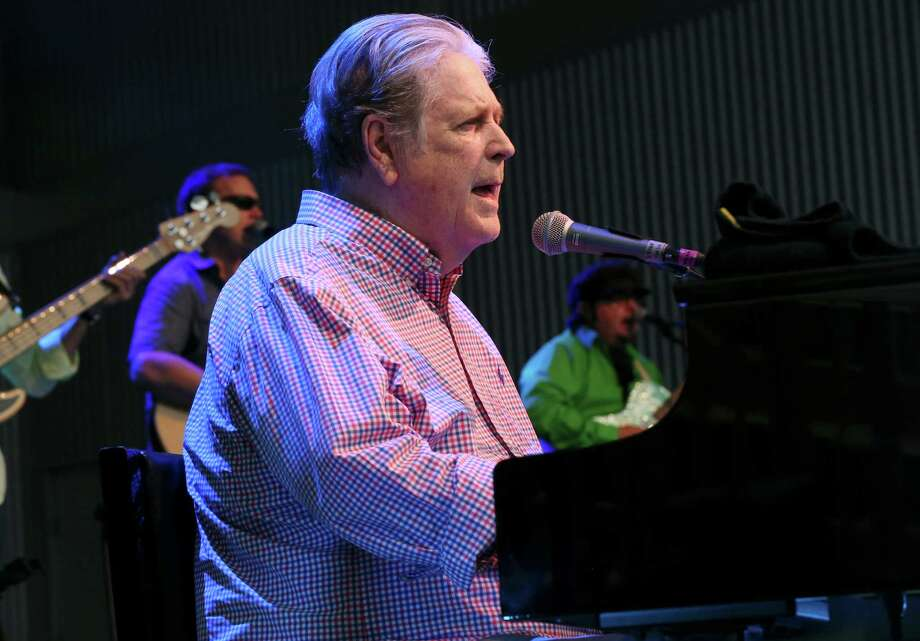 "Brian Wilson and his band will perform at the Toyota Oakdale Theatre on Tuesday, Sept. 27. In the midst of a world tour celebrating the 50th anniversary of ""Pet Sounds,"" he is seen here in concert in Roanoke, Va., in August. Photo: Heather Rousseau / Associated Press / The Roanoke Times"