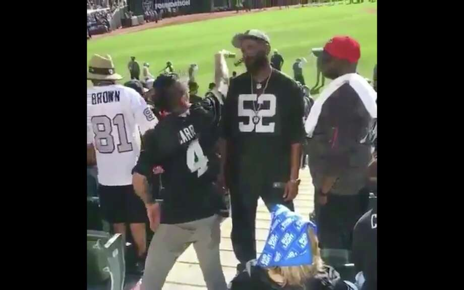A screenshot from the video of two Raiders fans fighting in the stands on Sept. 18, 2016. Photo: Screenshot