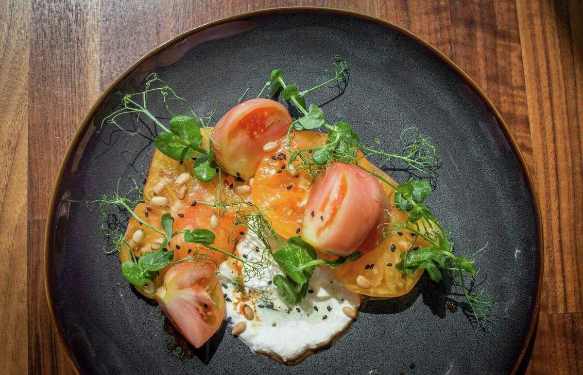 Triniti's tomato and house farmers cheese.