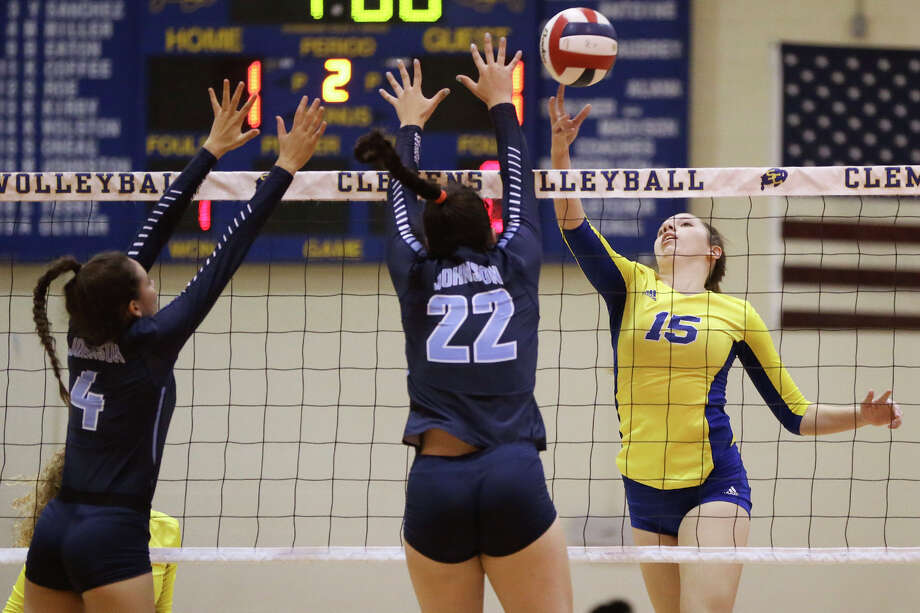 Clemens' Shelby O'Neal (from right) taps the ball past Johnson's Julia Deais and Adriana Pereira during their match at Clemens on Sept. 6, 2016. Photo: Marvin Pfeiffer /San Antonio Express-News / Express-News 2016