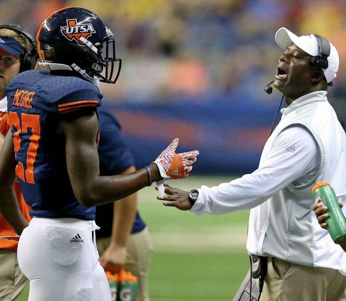 UTSA's Teddrick McGhee talks with coach Frank Wilson during a timeout in second-half action against Arizona State on Sept. 16, 2016 at the Alamodome.