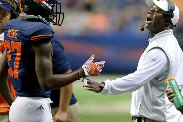 UTSA cornerback Teddrick McGhee talks with coach Frank Wilson during a timeout in second-half action against Arizona State on Sept. 16, 2016, at the Alamodome.