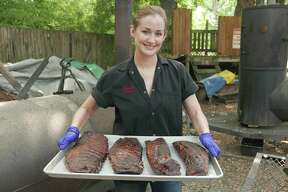 Pitmaster Laura Loomis of Two Bros. BBQ Market is one of the very few women pitmasters in the country.