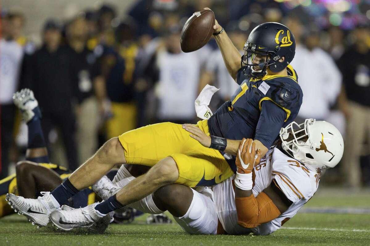Outside linebacker Malcolm Roach of the Texas Longhorns sacks quarterback Davis Webb of the California Golden Bears in the second quarter on Sept. 17, 2016 at California Memorial Stadium in Berkeley.