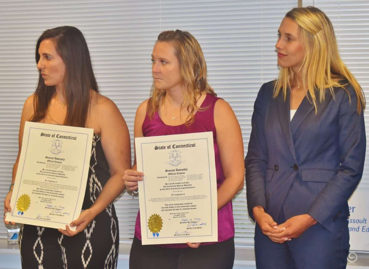 Jessica Feighan and Kerilyn Whitehead receive state citations for helping rescue a woman being kidnapped and sexually assaulted by two men in downtown Stamford at the end of 2014.