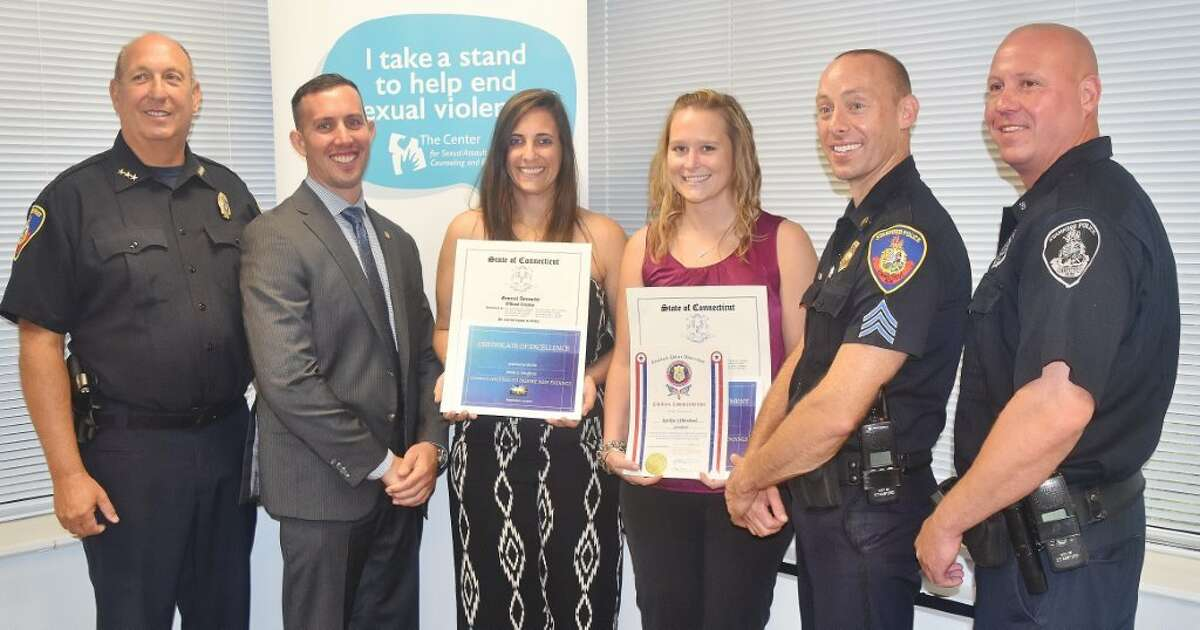 Chief Jon Fontneau, officer Sean Boeger, Jessica Feighan, Kerilyn Whitehead, Sgt. Rhett Connelly and officer Mark Zaramba at a ceremony Monday where Feighan and Whitehead were given citations for helping police stop the sexual assault of a woman in December 2014.