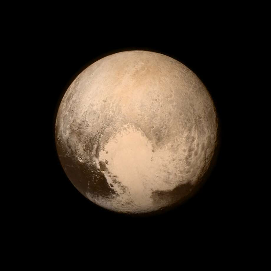 This NASA handout from the New Horizons spacecraft, was taken on July 13, 2015, when the spacecraft was 476,000 miles (768,000 kilometers) from the surface. It shows what appears to be a vast heart covering about a third of its hemisphere. Photo: Getty Images