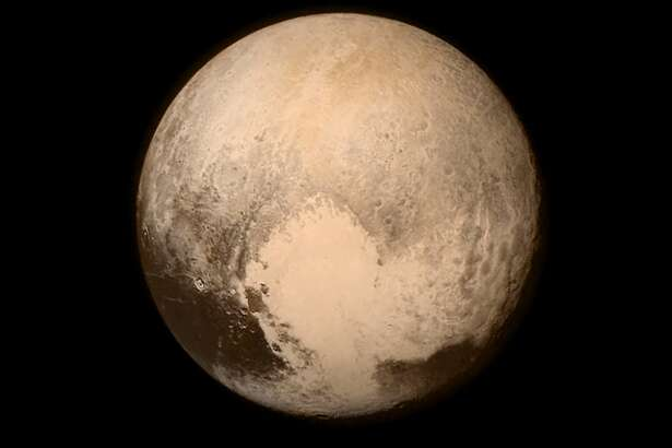 IN SPACE - JULY 14:  In this handout provided by the National Aeronautics and Space Administration (NASA), Pluto nearly fills the frame in this image from the Long Range Reconnaissance Imager (LORRI) aboard NASA's New Horizons spacecraft, taken on July 13, 2015, when the spacecraft was 476,000 miles (768,000 kilometers) from the surface. This is the last and most detailed image sent to Earth before the spacecraft's closest approach to Pluto. New Horizons spacecraft is nearing its July 14 fly-by when it will close to a distance of about 7,800 miles (12,500 kilometers). The 1,050-pound piano sized probe, which was launched January 19, 2006 aboard an Atlas V rocket from Cape Canaveral, Florida, is traveling 30,800 mph as it approaches.  (Photo by NASA/APL/SwRI via Getty Images)