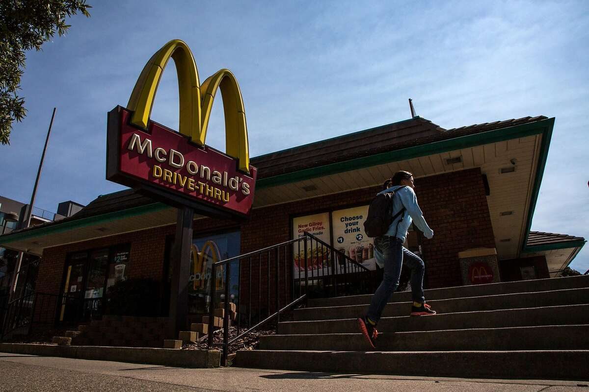 People head into McDonalds at Ocean Avenue on Monday, Sept. 19, 2016 in San Francisco, Calif. Fast-food restaurants are increasingly making commitments to reduce antibiotic use in the sources of the meat they serve, because of diners? concerns over antibiotic resistance, a global health threat.