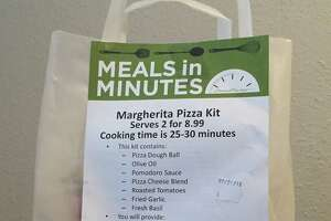 Central Market's pizza kit includes all the ingredients needed to make a very tasty pizza at home.