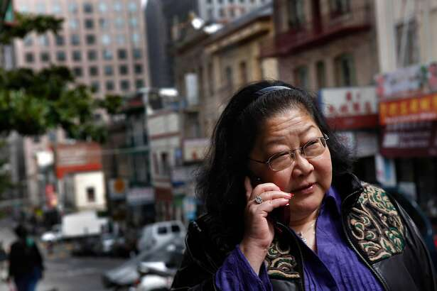 Rose Pak talks on her cell phone as she walks up Clay Street in Chinatown in San Francisco, Calif. on Friday September 17, 2010.