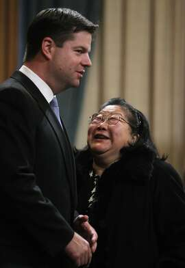 Rose Pak speaks with Supervisor Mark Farrell during a Board of Supervisors meeting at City Hall in San Francisco, Calif., on Saturday, Jan. 8, 2011.