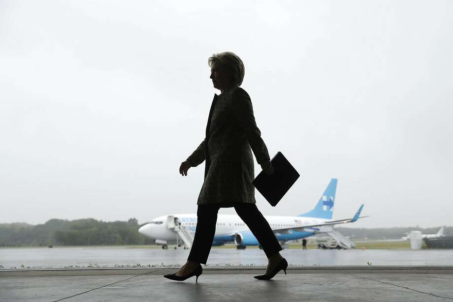 Democratic candidate Hillary Clinton prepares to hold a news conference at Westchester County Airport in White Plains, N.Y. Photo: Matt Rourke, Associated Press