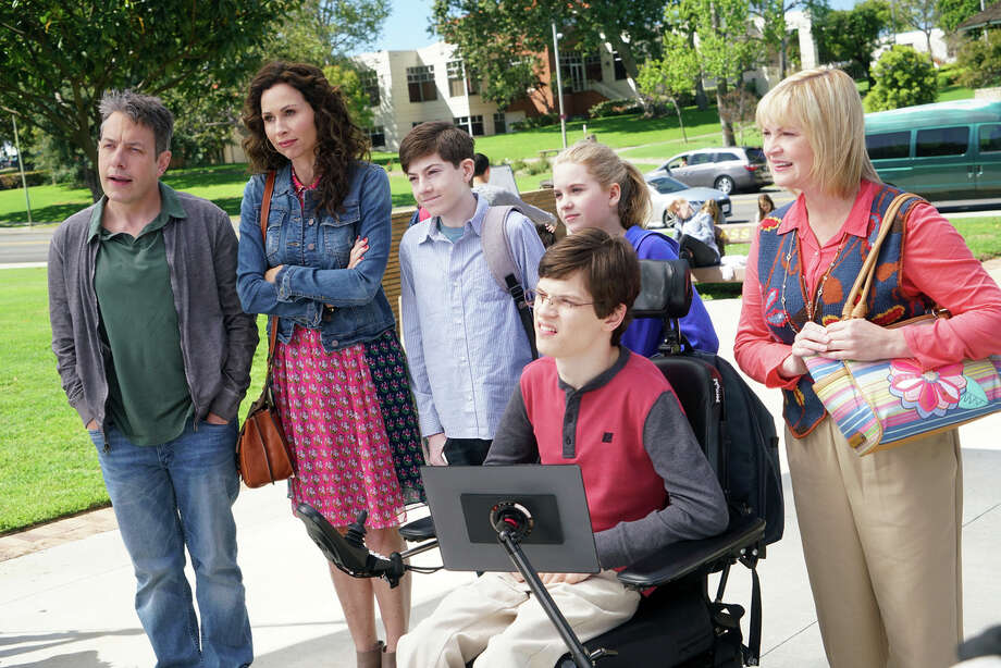 Above: Maya DiMeo (Minnie Driver, second from left) keeps moving her family to new school dis tricts to find the perfect situation for her son, JJ, (Micah Fowler, below, in an Emmy-worthy performance), who has cerebral palsy. Photo: Adam Taylor / Adam Taylor / ABC / © 2016 American Broadcasting Companies, Inc. All rights reserved.