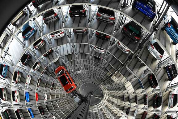 (FILES) This file photo taken on March 10, 2015 shows a VW Golf inside the so-called cat towers of car manufacturer Volkswagen AG (VW) at the company's assembly plant in Wolfsburg, northern Germany. One year after 'Dieselgate', Volkswagen (VW) faces lawsuits around the world. So far, VW has refused to compensate Europeans or buy back their vehicles -- as the firm has done for many US customers. Instead, it plans to retrofit the 8.5 million vehicles affected to meet emissions standards honestly. Experts predict that the total bill for Volkswagen could reach between 25 and 30 billion euros, leaving the firm once again raiding its piggy bank but not threatening its survival. / AFP PHOTO / TOBIAS SCHWARZTOBIAS SCHWARZ/AFP/Getty Images