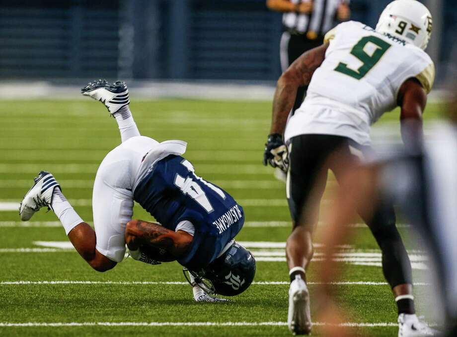 Rice cornerback J.T. Blasingame (14) intercepts a pass intended for Baylor wide receiver KD Cannon (9) during the first quarter of an NCAA football game at Rice Stadium on Friday, Sept. 16, 2016, in Houston. ( Brett Coomer / Houston Chronicle ) Photo: Brett Coomer, Staff / © 2016 Houston Chronicle