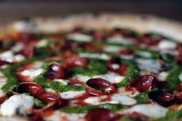 The Joan Marie pizza, pepperoni, housemade mozzarella, goat cheese and roasted jalapeno pesto at Cane Rosso Sept. 14, 2016, in Houston. ( James Nielsen / Houston Chronicle )