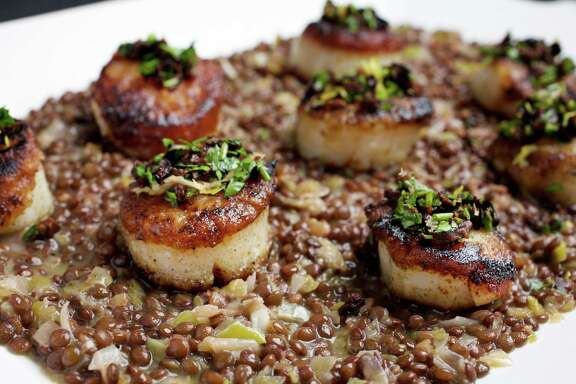 Pan-Roasted Scallops with Gremolata gain a nice brown crust courtesy of a one-side flour coating.