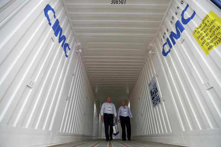 Billy Keys and Carlos Rodriguez check out the interior of a CIMC Intermodal Equipment container Monday during the Intermodal Expo at the George R. Brown Convention Center. Photo: Karen Warren, Staff Photographer / 2016 Houston Chronicle