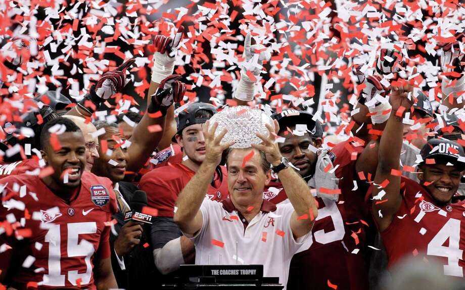"FILE - In this Jan. 9, 2012, file photo, Alabama head coach Nick Saban celebrates with his team after the BCS National Championship college football game against LSU, in New Orleans. Alabama won 21-0. The beginning of the decade, and of a dynasty.  The Crimson Tide has been unquestionably the dominant team of the decade to this point, riding Saban's ""Process"" and a string of top recruiting hauls to nearly annual title contention. (AP Photo/Gerald Herbert, File) ORG XMIT: NY168 Photo: Gerald Herbert / Copyright 2016 The Associated Press. All rights reserved. This m"